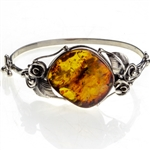 "This sterling silver bracelet features a gorgeous dark honey amber cabochon.. Bracelet size is 7.25"" diameter.  Cabochon size is approx 1"" x 1.25""."