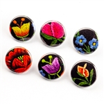 These small pinback buttons are bright and colorful, featuring traditional Polish folk designs on a black background. We make these buttons in house, a Polish Art Center exclusive! Set of 6 buttons.