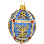 Simply egg-ceptional, this dazzling glass ornament was inspired by the famous jeweled eggs of the House of Faberge, in St. Petersburg, Russia. Featuring sparkling glitter folk patterns and glistening gold lines studded with sparkling red jewels, this