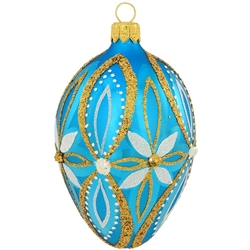 "Elegant flowers in shimmering glitter designs decorate this lovely, azure blue egg. A mix of springtime splendor and festive Christmas charm, this beautiful blue, white and gold egg ornament is masterfully crafted of glass in Poland and measures 3¾"" tall."