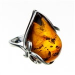 "Tear drop shaped amber cabochon set in sterling silver.  Amber size is approx. .75"" x .5"""