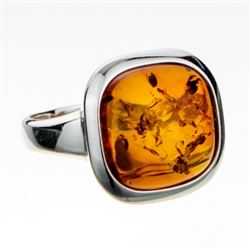 "Classic looking .5"" amber cabochon framed in sterling silver."