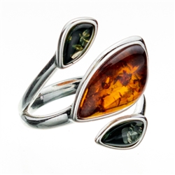 "Artistic sterling silver ring highlighting three amber cabochons.  Size is approx 1"" x .75""."