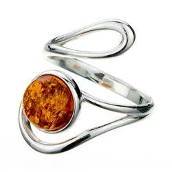 "Amber cabochon set in a stylish swirl of silver.  Amber cabochon is approx .4"" x .4""."