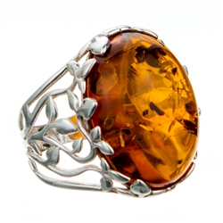 "Golden honey amber cabochon framed in a leafy silver setting.  Cabochon is approx .8"" x .6""."