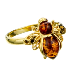 "Gold Plated Silver and Amber honey bee resting on a gold plated silver band.  Honeybee is approx .5"" x .6""."