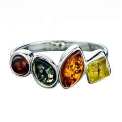 "Artist sterling silver ring featuring 4 shades of amber.  Size is approx 1"" x .25""."