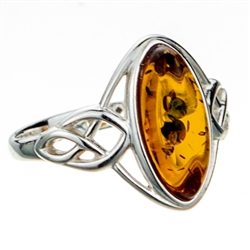 "Silver band with a Celtic design showcasing a honey amber cabochon.  Cabochon size is approx .6"" x .4""."
