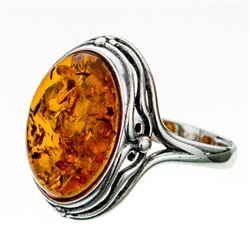 "Classic oval shaped amber cabochon set in sterling silver.  Size is approx .75"" x .5""."