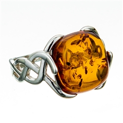 "Artistic Celtic design silver and amber ring.  Cabochon size is approx .5"" x .5""."