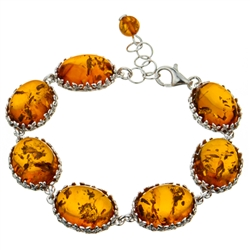 "7 elegant oval amber cabochons each set with sparkling sterling. 7.5"" long and adjustable smaller."