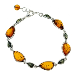 "11 elegant drops of amber each set in sterling silver. Bracelet length is 8"" long and adjustable smaller."