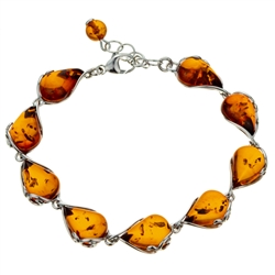 "9 elegant drops of amber each set in sterling silver. Bracelet length is 7.5"" and adjustable smaller."