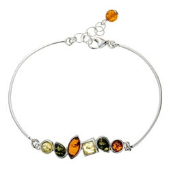 "This sterling silver bracelet features three shapes and shades of amber. This is a 7.5"" bracelet with a .5"" extender."