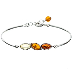 "This sterling silver bracelet features three amber cabochons.  This is a 7.5"" bracelet with a .5"" extender."
