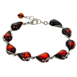 "9 elegant drops of cherry amber each set in sterling silver . Bracelet is 8"" long and adjustable smaller."