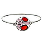 "This sterling silver bracelet features 2 cherry amber discs. Size is 7"" diameter"