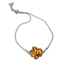 "This adjustable sterling silver bracelet features a silver and amber paw print. Bracelet can be adjusted to a maximum 8.5"" diameter."