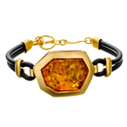 "This sterling silver bracelet features a honey color amber cabochon.. Bracelet size is 7.5"" diameter. Cabochon size is approx 1"" x .75"""