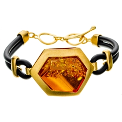 "This gold plated silver bracelet features a honey color amber cabochon.. Bracelet size is 7.5"" diameter. Cabochon size is approx 1"" x .75""."