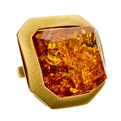 "Sparkling honey amber cabochon set in a gold vermeil adjustable (one time) ring. Size approx. 1"" x 1"" x .5""."