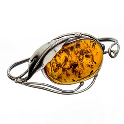 "This sterling silver bracelet features a gorgeous oval amber cabochon. Size is 7"" diameter. Cabochon size is approx 1"" x 1.3""."