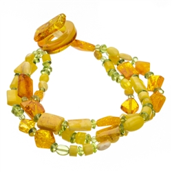Bozena Przytocka is a designer of artistic amber jewelry based in Gdansk, Poland. Here is a stunning example of her use of amber and peridot to create a beautiful and unique bracelet. Includes faceted amber beads.