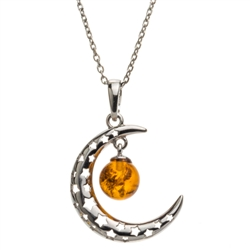 "Sterling silver moon suspending beautiful honey amber cabochon drop. Pendant size is approx. 1.2"" x .8""."