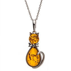 "Sterling silver and amber kitty cat. Pendant size is approx. 1.5"" x .6""."