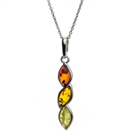 "Sterling silver frames suround these three drops of amber in three colors. Pendant size is approx. 1.5"" L  x .25"" W."