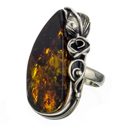 "A beautiful amber cabochon framed in a classic sterling silver frame. Size is approx 1.25"" x .8""."