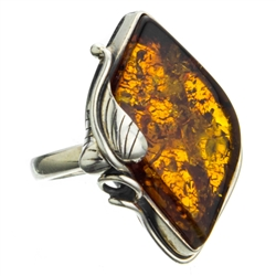 "A beautiful amber cabochon framed in a classic sterling silver frame. Size is approx 1.25"" x 1""."