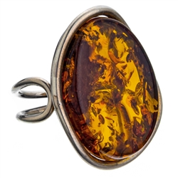 "A beautiful honey amber cabochon framed in a classic sterling silver frame. Size is approx 1.25"" x 1"". Adjustable one time between size 6 to 9."