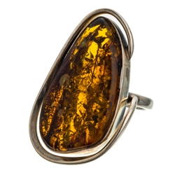 "A beautiful amber cabochon framed in a classic sterling silver frame. Size is approx 1.5"" x .8""."