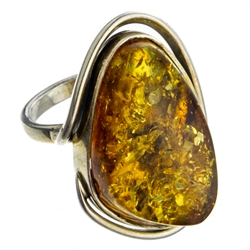 "A beautiful amber cabochon framed in a classic sterling silver frame. Size is approx 1.25"" x .75""."