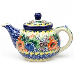"Beautiful teapot with an 10oz capacity. Pattern designed by master artist Maria Starzyk . The artist has been connected with Handicraft Cooperative ""Artistic Ceramics and Pottery"" since 1995, whereas since 1997 she has been a pattern designer."