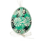 This beautifully designed quail egg is dyed one color, then white wax is melted and applied to form an intricate design which is left on the surface. Please note that quail eggs shells are naturally speckled brown and black and the black surfaces remain