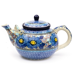 "Beautiful large teapot with spout handle for pouring ease. Holds 1.8 liters (1.9 quarts).  Pattern design by master artist Teresa Liana. The artist has been connected with the Artistic Handicraft Cooperative ""Artistic Ceramics and Pottery"" since 1983."