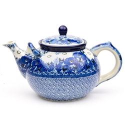 "Beautiful large teapot with spout handle for pouring ease. Holds 1.8 liters (1.9 quarts). Pattern designed by master artist Maria Starzyk . The artist has been connected with Handicraft Cooperative ""Artistic Ceramics and Pottery"" since 1995, whereas since"
