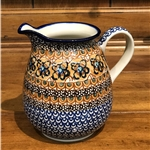 "Designed by master artist Maria Iwicka. The artist has been connected with the Artistic Handicraft Cooperative ""Artistic Ceramics and Pottery"" since 1981. Since 1993 she has been a pattern designer. Unikat pattern number U1592."