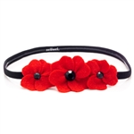 Beautiful handmade felt poppy headpiece. No slip grip elastic band (Scunci Brand).  One size fits all.