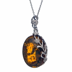 "A beautiful honey amber cabochon framed in an open back sterling silver frame. Pendant size is approx. 1.1"" x .9""."