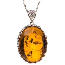 "Beautiful amber cabochon surrounded by a sterling silver frame on an adjustable length chain.  Pendant size is approx. 1.25"" x 1""."
