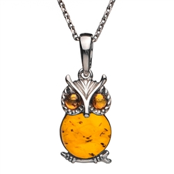 "Sterling silver and honey amber owl. Pendant size is approx. .75"" h x .5"" w."