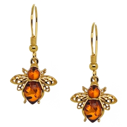 "A pair of gold plated silver honey bees with golden honey amber orbs. Size approx 1.25"" x .5""."