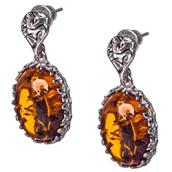"Gorgeous Baltic Amber earrings surrounded with a ring of Sterling Silver filigree work. Approx 1.2"" long x .5"" wide."