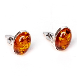 "Beautiful pair of oval shaped amber and silver earrings. Size is approx .5"" x .4""."