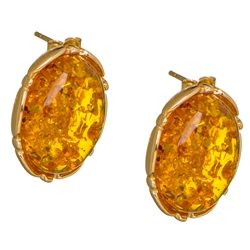 "Gorgeous Baltic Amber earrings surrounded with a ring 14kt gold. Size is approx 1"" long x .75"" wide.  Weight is approx 9.5 grams.  Matching pendant is available."