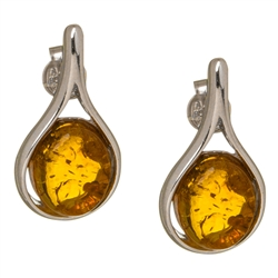 "Baltic Amber earrings framed with a ring of sterling silver. Size is approx .75"" long x .4"" wide."