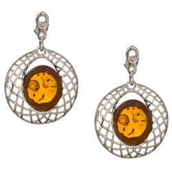 "Gorgeous Baltic Amber earrings surrounded with a ring of Sterling Silver filigree work. Approx 1.5"" long x 1.1"" wide."